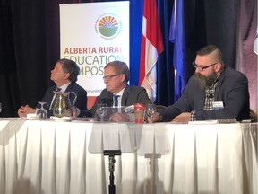 Cabinet ministers Oneil Carlier, minister of agriculture and forestry, David Eggen, minister of education, and Shaye Anderson, minister of municipal affairs, speak to rural school board trustees and leaders from across the province at the Alberta Rural Education Symposium in Edmonton on Sunday, March 3, 2019.