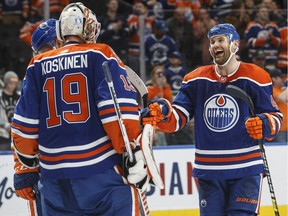 Edmonton Oilers goalie Mikko Koskinen (19) and Zack Kassian (44) celebrate the win over the Vancouver Canucks'during third period NHL action in Edmonton, Alta., on Thursday March 7, 2019.