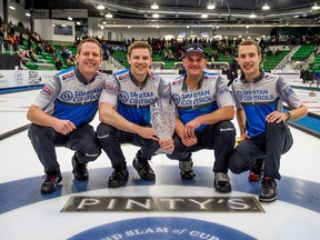 Skip Brendan Bottcher, right, celebrates his win with teammates Karrick Martin, left, Bradley Thiessen, centre left, and Darren Moulding at the men's final of the Humpty's Champions Cup against Team Koe in Saskatoon, on Sunday April 28, 2019. (THE CANADIAN PRESS/Matt Smith)