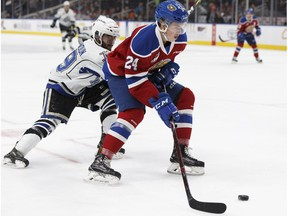 Brett Kemp (24) battles Dante Hannoun (19) during a WHL game between the Edmonton Oil Kings and the Victoria Royals at Rogers Place in Edmonton on Wednesday, Oct. 18, 2017.