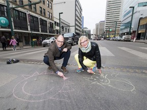 Paths for People chairman Dave Buchanan and volunteer Theresa Agnew on Jasper Avenue, which the organization hopes to shut for a street festival on Aug. 25.