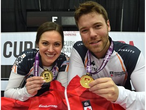 Laura Crocker and Kirk Muyres hold up their gold medals after defeating Team Kadriana Sahaidak and Colton Lott 8-7 in the gold-medal final of last year's Canadian Mixed Doubles Curling Championship at the Leduc Recreation Centre. The community is becoming quite the curling destination, with a pair of championship events now scheduled for this winter.