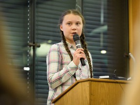 """Swedish environmental campaigner Greta Thunberg addresses politicians, media and guests with the Houses of Parliament on April 23, 2019 in London, England. Her visit coincides with the ongoing """"Extinction Rebellion"""" protests across London, which have seen days of disruption to roads and transport systems, in a bid to highlight the dangers of climate change."""