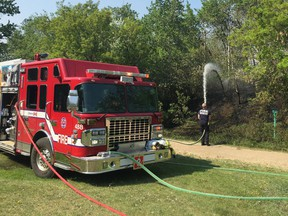 Firefighters battle a brush fire in Mill Creek Ravine Tuesday, May 28, 2019.