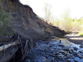 An exposed storm drainage line hangs over Mill Creek on May 21, 2019. Erosion is creating safety issues, according to nearby resident Allan Bolstad.