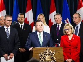 Finance Minister Travis Toews and Premier Jason Kenney address the provinces financial situation along with  Janice MacKinnon, a former Saskatchewan finance minister, and chair of a blue-ribbon panel announced on Tuesday, May 7, 2019, in Edmonton .