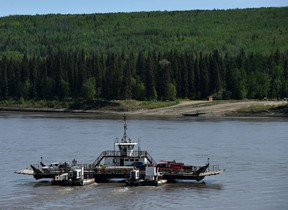 The La Crete ferry crosses the Peace River on May 25. Southwest movement of the Chuckegg Creek wildfire prompted the evacuation Wednesday of the La Crete Ferry Campground.