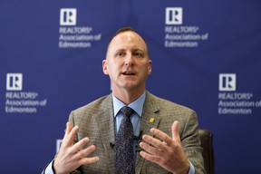 Realtors Association of Edmonton chairman Michael Brodrick speaks about real estate market highlights from the second quarter of 2019 at the association's offices in Edmonton, on Wednesday, July 3, 2019.