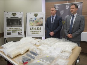 ALET CEO Chad Coles, left, and RCMP Staff Sgt. Carson Creaser answers questions related to a two-year investigation by ALERT that has cut off a drug pipeline between B.C. and Alberta. More than $2 million in drugs and cash was seized and a dozen suspects have been arrested on Wednesday, June 12, 2019.