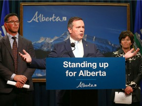 Alberta Premier Jason Kenney (C) is joined by MInister of Justice and Solicitor General Doug Schweitzer (L) and Minister of Energy Sonya Savage in Calgary on Thursday, July 4, 2019 and Kenney announced the launch of a public inquiry into the foreign funding of anti-Alberta energy campaigns.