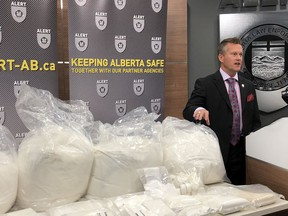 The Alberta Law Enforcement Response Teams (ALERT) showed a stash of cocaine, ketamine and cutting agent phenacetin seized in June 2019 from two Edmonton residences during a July 18 news conference. The drugs are worth $1.4 million, said Insp. Marc Cochlin, executive officer in charge of ALERT in Edmonton.