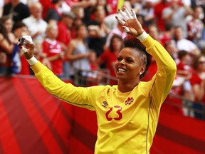 Karina LeBlanc of Canada waves to the fans after Canada's win at the FIFA Women's World Cup Canada 2015 Round 16 match against Switzerland at B.C. Place Stadium in Vancouver, on June 21, 2015.
