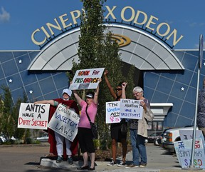 An Alberta pro-choice group protests at South Common in Edmonton on Friday, July 12, 2019,  against Cineplex's choice to screen the film Unplanned to state unequivocally that hard-fought health care rights are not up for debate.