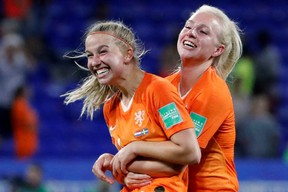 Netherlands' Jackie Groenen (left) and Inessa Kaagman (right) celebrate their victory over Sweden in the FIFA Women's World Cup semifinal in Lyon, France, on Wednesday, July 3, 2019.