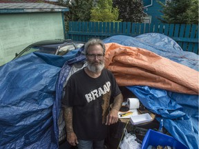 In the driveway behind the home of Candas Jane Dorsey where the city previously threatened to remove the belongings of Daryl Hendricks, a homeless man that Candas has allowed to camp on her property.  Photo by Shaughn Butts / Postmedia