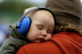 Jude Reeves (15 months old) was lulled to sleep by the music at the 2019 Edmonton Folk Music Festival while in the arms of dad Michael Jensine at Gallagher Park.
