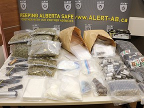 Three stolen handguns and more than $560,000 worth of drugs and cash have been seized after ALERT searched two Edmonton homes, ALERT said in a news release on Tuesday, Aug. 13, 2019.