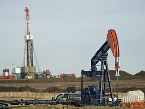 Pumpjack works in the foreground with a drilling rig in the back, a few years ago. The drilling sector has already seen 20 of its best drilling rigs move south in recent years. . Ian Kucerak/Edmonton Sun/QMI Agency