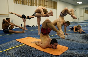 Yoga practitioners prepare for the Canadian Yoga Championships at Studio X Bikram Yoga in Edmonton on Thursday August 15, 2019. The competition will he held in the Pearl Showroom at Casino Yellowhead in Edmonton on August 24, 2019. (PHOTO BY LARRY WONG/POSTMEDIA)