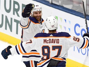Zack Kassian and Connor McDavid of the Edmonton Oilers celebrate a second period goal by Kassian during their game against the New York Islanders at the NYCB's LIVE Nassau Coliseum on Oct. 8, 2019 in Uniondale, N.Y.