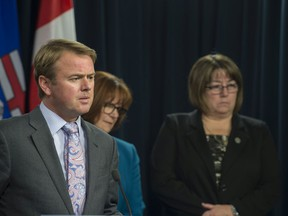 Health Minister Tyler Shandro outlined the expanded  role of licensed practical nurses in Alberta at the Alberta Legislature on October 17, 2019. On stage with him was Linda Stanger, CEO at College of Licensed Practical Nurses of Alberta and Valerie Paice, President, College of Licenced Practical Nurses of Alberta.
