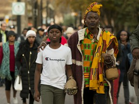 Wearing a durag Emmell Summerville, 11, his mother Una Momolu and supporters march to Edmonton Catholic School Board offices, in Edmonton Thursday Oct. 17, 2019. Momolu is calling on the Catholic Public School Board to apologize to Emmell after accusing him of potential gang affiliations because he would not remove his durag at Christ The Kings School. Photo by David Bloom