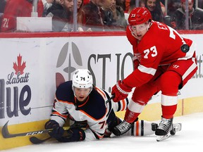 Edmonton Oilers defenceman Ethan Bear (74) and Detroit Red Wings left wing Adam Erne (73) battle for the puck in the second period at Little Caesars Arena on Tuesday, Oct. 29, 2019.