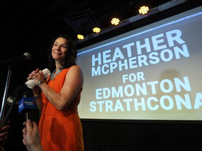 NDP supporters watch results at Edmonton-Strathcona NDP candidate Heather McPherson's election event at the Grindstone Theatre, 10019 81 Ave. Photo by David Bloom