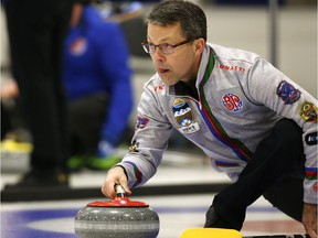 Skip Dale Goehring shoots during a game against the Sluchinski rink at the 2019 Alberta Boston Pizza Cup Men's Curling Championship at Ellerslie Curling Club in Edmonton, on Wednesday, Feb. 6, 2019. Photo by Ian Kucerak/Postmedia