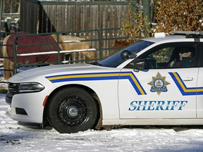 A sheriff watches a property in Wetaskiwin County on November 6, 2019, when the Alberta government announced their initial plan to combat rural crime in Alberta.