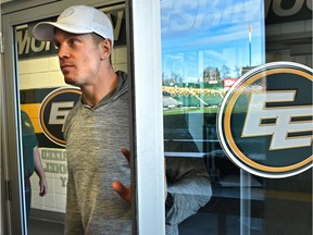 Eskimos quarterback Trevor Harris opens a door with the Commonwealth Stadium field reflected off the glass, on his way to speak to the media after their season ended in the Eastern Finals Sunday losing to Hamilton, in Edmonton, November 18, 2019.