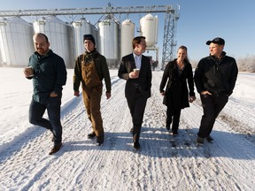 Agriculture and Forestry Minister Devin Dreeshen (centre) speaks with Mulligan Farm family members after a press conference on the Farm Freedom and Safety Act on the Mulligan Farm in Sturgeon County outside of Edmonton, on Wednesday, Nov. 20, 2019.