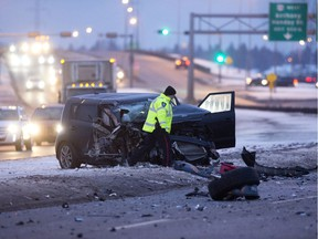 Police investigate at the scene of a two vehicle collision along north bound 91 Street south of the Anthony Henday, in Edmonton. File photo.