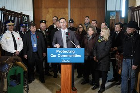 Doug Schweitzer (at podium, Alberta Minister of Justice and Solicitor General) announced the government's initial plan to combat rural crime in Alberta on Wednesday November 6, 2019. The announcement was made at a private ranch in Wetaskiwin County. (PHOTO BY LARRY WONG/POSTMEDIA)