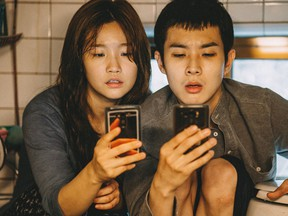Woo-sik Choi and So-dam Park in Parasite.