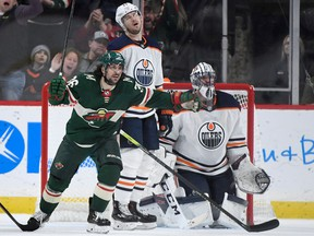 ST PAUL, MINNESOTA - DECEMBER 12: Mats Zuccarello #36 of the Minnesota Wild celebrates a goal by teammate Eric Staal (not pictured as Oscar Klefbom #77 and goaltender Mike Smith #41 of the Edmonton Oilers look on during the third period of the game at Xcel Energy Center on December 12, 2019 in St Paul, Minnesota. The Wild defeated the Oilers 6-5.