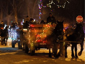 Revelers take a horse drawn sleigh ride during the first-ever Car-free Night at Candy Cane Lane in the Crestwood neighbourhood of Edmonton, on Thursday, Dec. 12, 2019. The event, which is over 50 years old, is a fundraiser for Edmonton's Food Bank.
