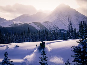 A snowmobiler riding in the Kakwa region of the North Rockies.