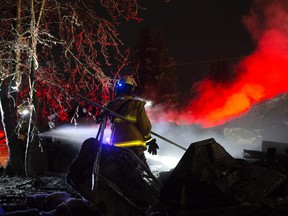Firefighters return to the scene of a fatal house fire in the hamlet Rochfort Bridge, Friday Dec. 6, 2019. firefighters were returning to dose hotspots at the home where earlier five people were found dead.
