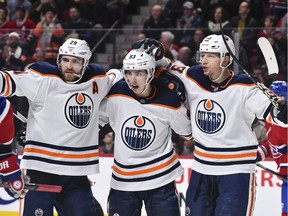 Ryan Nugent-Hopkins #93 of the Edmonton Oilers (C) celebrates a goal with teammates Leon Draisaitl #29 (L) and Alex Chiasson #39 (R) during the third period against the Montreal Canadiens at the Bell Centre on January 9, 2020 in Montreal.
