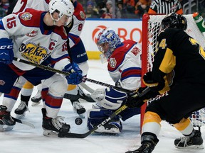 The Edmonton Oil Kings' goaltender Beck Warm (1) makes a save against the Brandon Wheat Kings' Connor Gutenberg (24) during second period WHL action at Rogers Place, in Edmonton Tuesday Jan. 28, 2020.