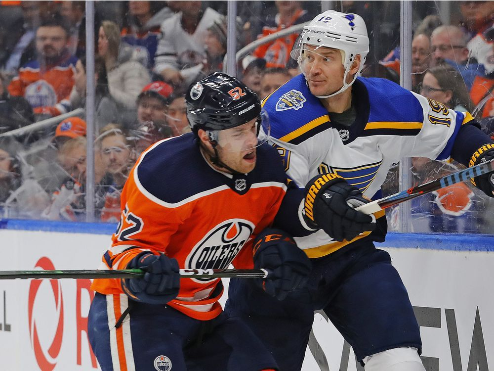 Oilers forward Patrick Russell (52) checks St. Louis Blues defensemen Jay Bouwmeester (19) during the first period at Rogers Place, Nov 6, 2019.