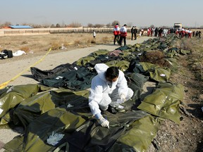 Passengers' bodies in plastic bags are gathered at the site where the Ukraine International Airlines plane crashed after take-off from Iran's Imam Khomeini airport, on the outskirts of Tehran, Iran January 8, 2020.