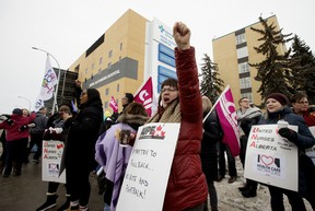 Members of the United Nurses of Alberta rally in support of publicly delivered healthcare and front-line workers, outside the Royal Alexandra Hospital in Edmonton Thursday Feb. 13, 2020. The protests were held at 33 locations in 25 communities across the province. Photo by David Bloom