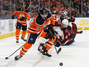 Edmonton Oilers defenceman Ethan Bear battles Colorado Avalanche forward Nazem Kadri during the second period of a NHL hockey game at Rogers Place in Edmonton on Nov. 14, 2019.