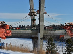 The first cable stays to support the new Tawatinâ Bridge have been installed that stabilize the construction allowing it to proceed across the North Saskatchewan River for the Southeast Valley Line LRT in Edmonton, January 30, 2020. Ed Kaiser/Postmedia