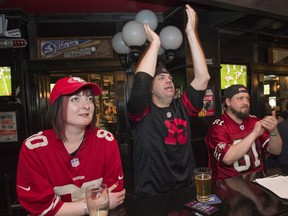 San Francisco fans Vesna Vorih, left, Brian Campbell and Garrett Hill watch the Super Bowl at the downtown location of The Pint on Sunday, Feb. 2, 2020.