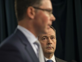 Premier Kenney and Doug Schweitzer, Minister of Justice and Solicitor General, will talk about Bill 1 that will prohibit protesters from blocking rail lines, its the Critical Infrastructure Defence Act on February 25, 2020. Photo by Shaughn Butts / Postmedia