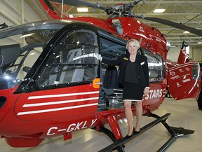 STARS president and CEO Andrea Robertson on an Airbus H145 helicopter at Edmonton International Airport on Wednesday, Feb. 5, 2020 after Capital Power announced funding of $1 million in support of the STARS air ambulance fleet renewal project.