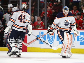 Mikko Koskinen (19) of the Edmonton Oilers replaces Mike Smith (41) in the second period against the Chicago Blackhawks at United Center on March 05, 2020, in Chicago.